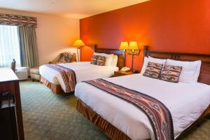 A bed or beds in a room at Hualapai Lodge