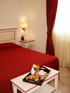 Letto o letti in una camera di Alla Corte Del Picchio Room & Breakfast