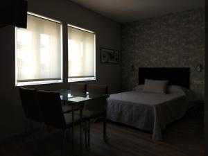 A bed or beds in a room at Apartamentos Mitreo