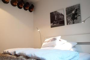 A bed or beds in a room at Müller Inn B&B