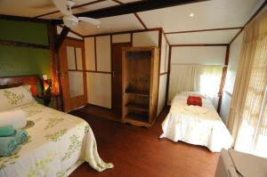 A bed or beds in a room at Abayomi Pousada