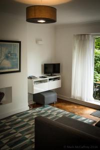 A television and/or entertainment center at Garden Apartment w/ easy access to central London
