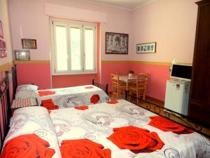A bed or beds in a room at Da Nonna Maria B&B