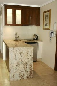 A kitchen or kitchenette at The Byron Beach House