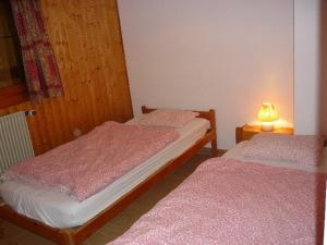 A bed or beds in a room at Squaw Valley