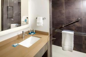 A bathroom at Hyatt House Denver Lakewood Belmar