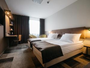Q Hotel Plus Katowiceにあるベッド