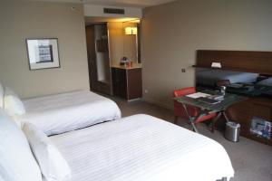 A bed or beds in a room at Pullman Sydney Olympic Park