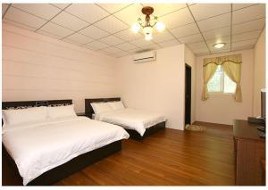 砂婆礑樂活園民宿一館 房間的床