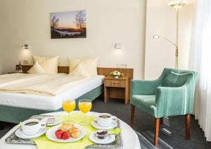 Ein Bett oder Betten in einem Zimmer der Unterkunft Portens Hotel Fernblick