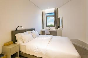 A bed or beds in a room at H Avenue Hotel Idae Shinchon