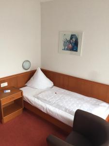 Кровать или кровати в номере Hotel Martina