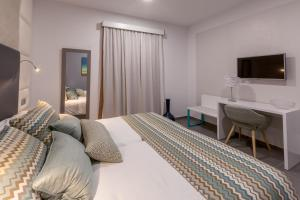 A bed or beds in a room at Silvi Villas by TAM Resorts
