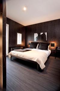 Cama o camas de una habitación en Design Hotel Modez