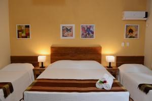 Cama ou camas em um quarto em Pousada Moryba