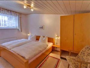 A bed or beds in a room at Ferienwohnung Breitenbrunn ERZ 1031