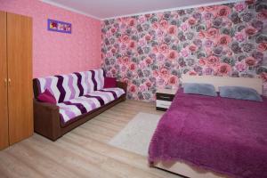 Кровать или кровати в номере Апартаменты на Ленина 103