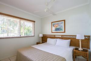 A bed or beds in a room at Port Douglas Plantation Resort