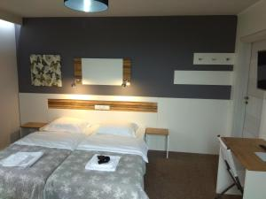 A bed or beds in a room at Sleepinn Gdansk Airport