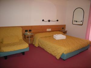 Кровать или кровати в номере Albergo Pozzole