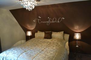 Ein Bett oder Betten in einem Zimmer der Unterkunft Gästehaus Graul