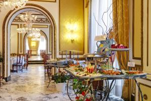 A restaurant or other place to eat at Excelsior Palace Palermo