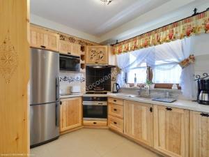 Kuchnia lub aneks kuchenny w obiekcie Lux-Apart Zakopane
