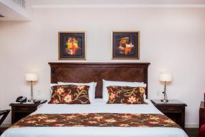 Cama o camas de una habitación en Hotel Casino Acaray