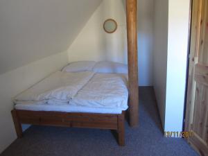 Postel nebo postele na pokoji v ubytování Horská Chata U Básníka