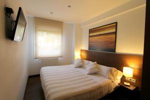 Cama o camas de una habitación en Pensión Grosen