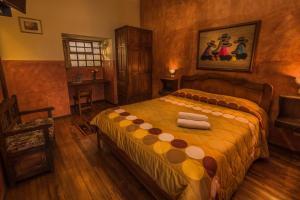 Cama o camas de una habitación en Hotel San Francisco De Quito
