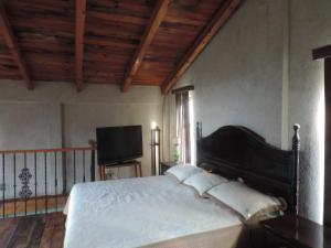 Cama o camas de una habitación en Rancho los Madroños