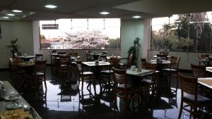 A restaurant or other place to eat at Universo Hotel