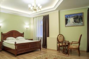 A bed or beds in a room at Boutique Hotel Stolitsa