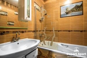 Ванная комната в Depart ApartHotel In Panorama