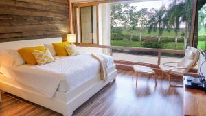 A bed or beds in a room at Los Altos Casa de Campo