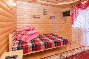 Ліжко або ліжка в номері Karpatskyi Diamant