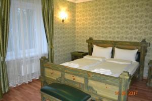 Кровать или кровати в номере Отель XLcomplex