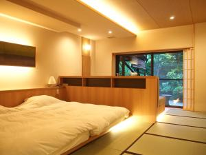 A bed or beds in a room at Yoshimatsu