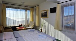 A bed or beds in a room at Resort Sv. František - Hotel Erlebachova Bouda