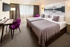 A bed or beds in a room at Mercure Swansea Hotel