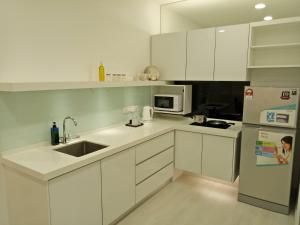 A kitchen or kitchenette at Georgetown 2Br Suite, Penang