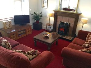 A television and/or entertainment centre at In House Garden Flat