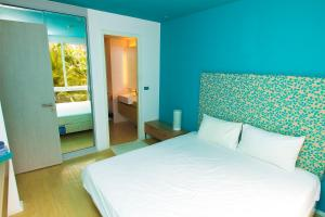 A bed or beds in a room at Atlantis Condo Jomtien Pattaya