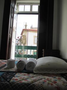 A bed or beds in a room at Guesthouse da Sé