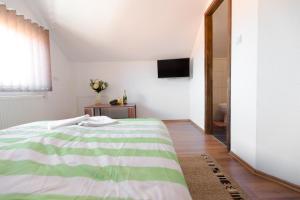 Ein Bett oder Betten in einem Zimmer der Unterkunft Guesthouse Vila Puzic