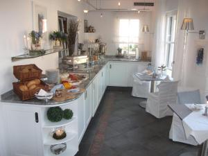 Ein Restaurant oder anderes Speiselokal in der Unterkunft Landgasthof Weisses Lamm