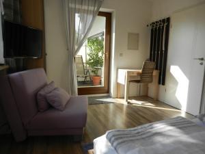 Ein Sitzbereich in der Unterkunft Apartment am Stadtpark