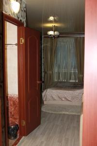 Кровать или кровати в номере Hotel Uyut on Rudnevka