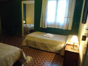 Una cama o camas en una habitación de Gran Aldea Hotel
